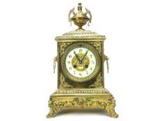 AN EARLY 20TH CENTURY GILT METAL MANTEL CLOCK