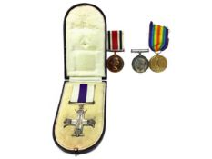 A MILITARY CROSS AND THREE OTHER MEDALS