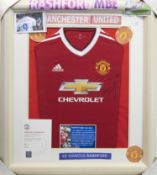 A SIGNED MANCHESTER UNITED FOOTBALL CLUB JERSEY