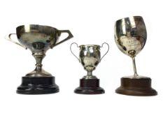 A LOT OF THREE BURNHAM YACHT CLUB SILVER TROPHIES AWARDED TO IWUNDA