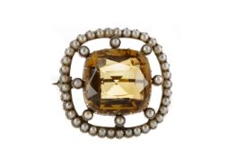 A YELLOW GEM SET AND SEED PEARL BROOCH