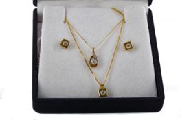 TWO GOLD PENDANTS AND A PAIR OF GOLD EARRINGS