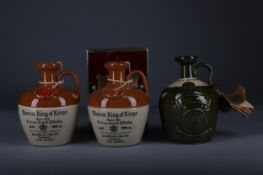 TWO KING OF KINGS DECANTERS AND ONE KING'S RANSOM DECANTER