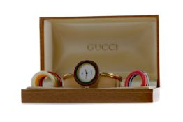 A LADY'S GUCCI GOLD PLATED QUARTZ WRIST WATCH