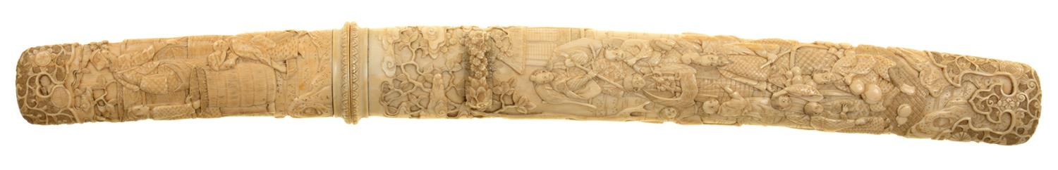 Lot 294 - A JAPANESE DAGGER, THE IVORY SAYE CARVED WITH CONTINUOUS SCENES BETWEEN PRUNUS BLADE 25.5CM L, 43.