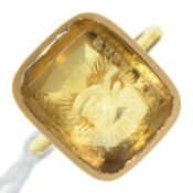 A GOLD AND CITRINE SIGNET RING, 19TH C, 3.9G, SIZE G Adapted from a seal; light wear consistent with
