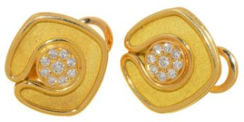 A PAIR OF DIAMOND AND 18CT TWO COLOUR GOLD EARRINGS BY DE VROOMEN, WITH PAVÉ SET CENTRE, CLIP