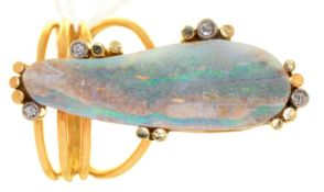 AN OPAL AND DIAMOND RING, THE IRREGULAR OPAL SECTION WITHIN DIAMOND ACCENTS, IN GOLD, WIREWORK HOOP,