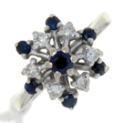 A SAPPHIRE AND DIAMOND CLUSTER RING, IN 18CT WHITE GOLD, BIRMINGHAM 1975, 4.4G, SIZE M½ Good