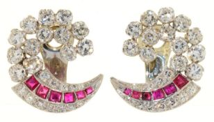 A PAIR OF RUBY AND DIAMOND SWIRL EARRINGS, IN WHITE GOLD, CLIP FITTING, 23MM, 12G Good condition
