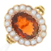 A CITRINE AND SPLIT PEARL CLUSTER RING,  ON ASSOCIATED GOLD HOOP WITH PIERCED SHOULDERS, UNMARKED,