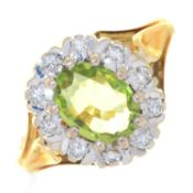 A PERIDOT AND DIAMOND CLUSTER RING, IN  18CT GOLD, LONDON 1972, 4G,  SIZE K Good condition