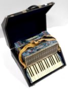 A HOHNER CARMEN II PIANO ACCORDION, RIGID CASED In apparently good condition, bellows / mechanism
