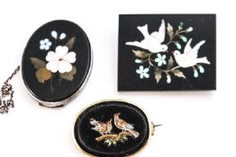 A collection of three pietra dura brooches of variable designs.