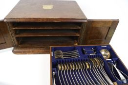 An oak canteen of cutlery,