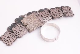A silver bracelet attributed to Charles Horner, Chester hallmarks and a silver plated belt