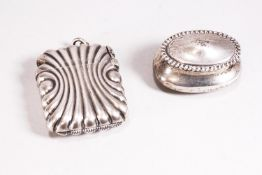 A small silver oval bellied pill box with domed cover set a rope work edge, Birmingham 1900,