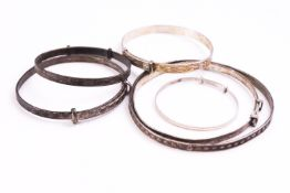 A collection of six expanding bangles, all marked or hallmarked for silver. Gross weight: 37.
