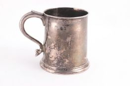 A small silver plain mug, of tapered round form,