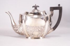 A silver teapot, of shaped oval form,