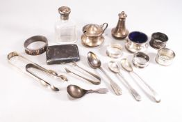 A pair of Old English pattern silver tongs, London 1803, 14cm long, with a selection of other items,