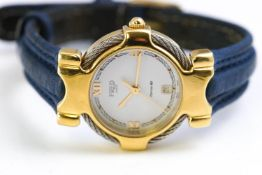 A mixed metal quartz dress watch. Dial signed Fred Paris. Date feature; leather strap.