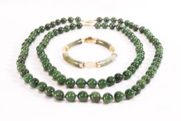 Two strands of nephrite jade beads,