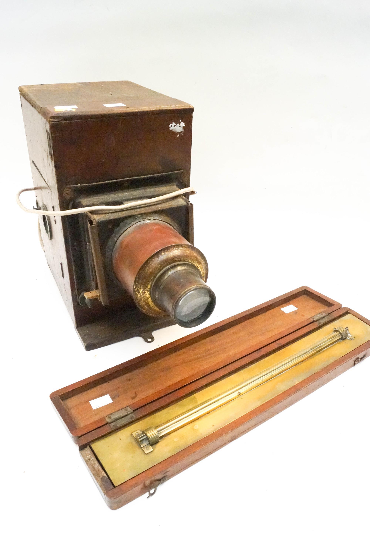 Lot 42 - A mahogany magic lantern and a mahogany cased rolling ruler