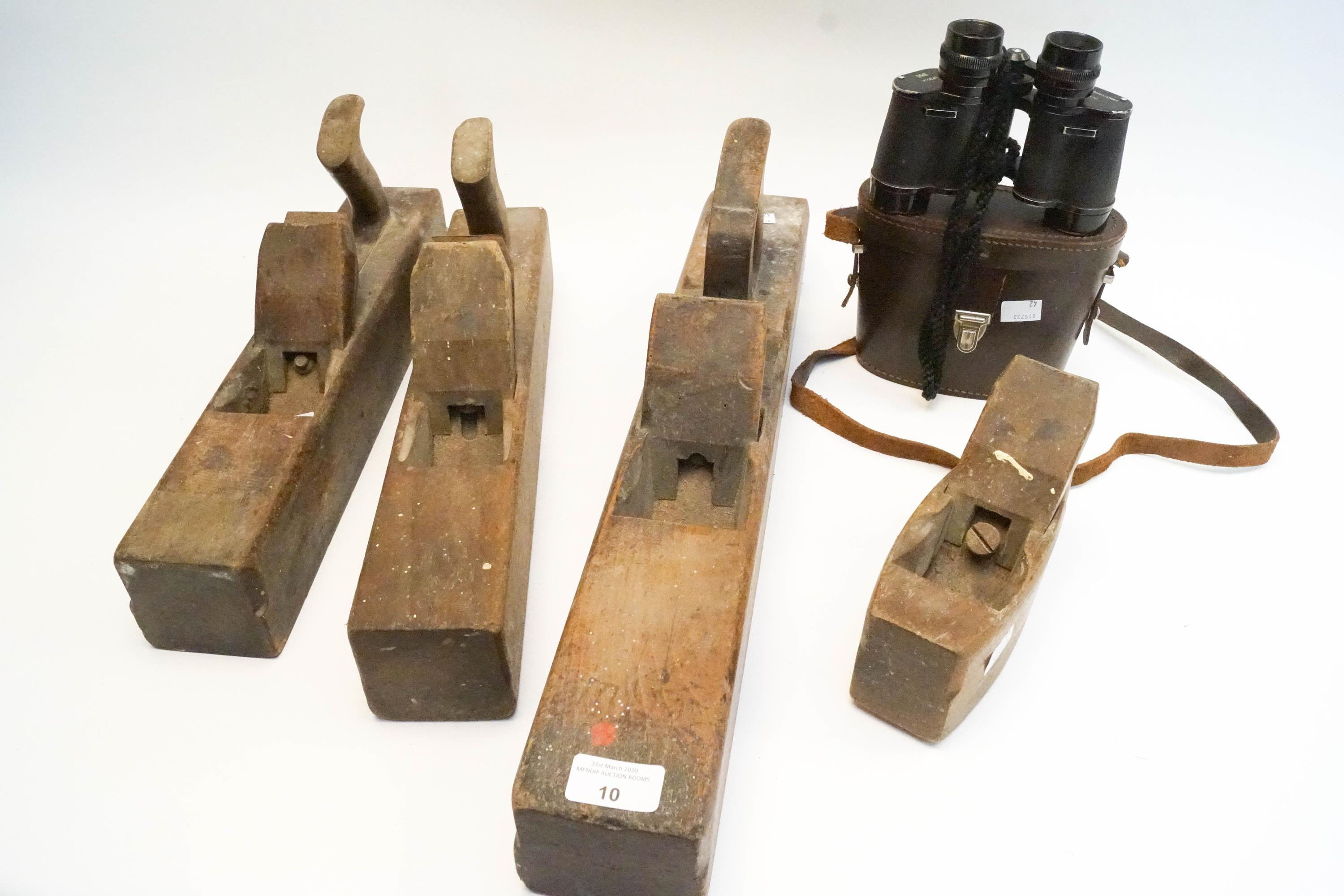 Lot 10 - Four wood planes and a pair of binoculars
