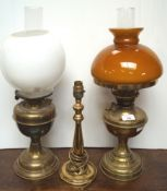Two brass oil lamps and another light