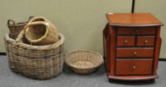 A group of baskets and a side table