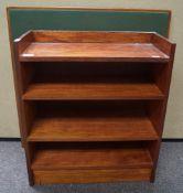 A folding card table and a mahogany bookcase