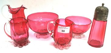 Six pieces of cranberry glass
