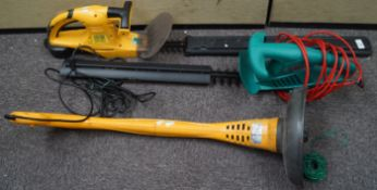 A hedge trimmer and a strimmer