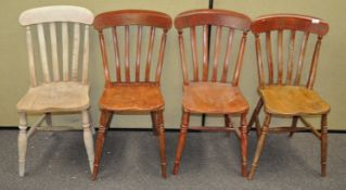 A set of four stick back chairs