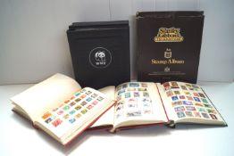 Five stamp albums