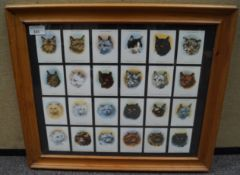 A collection of Players cigarette cat cards
