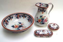 A late 19th century pottery wash jug and basin, decorated in underglaze blue,