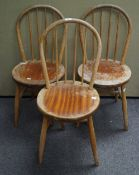 Three kitchen chairs and two others