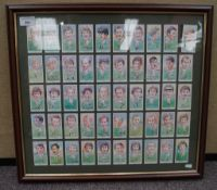 A group of framed cigarette card style rugby cards