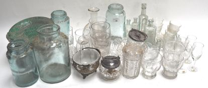 A cut glass jam pot with silver plated mounts and other glass