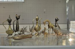 A group of brass animals and other items