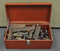 A tool chest containing a quantity of wood planes