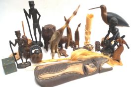 A quantity of African carved wood and other figures