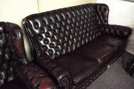 A leather button back three seat sofa