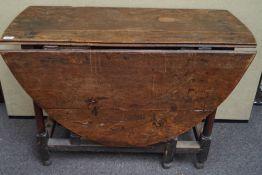 An 18th century elm gate leg table