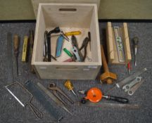 A wooden box with lid and sundry tools