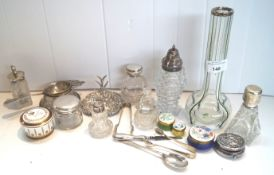 A silver ring stand, various silver mounted dressing table jars,