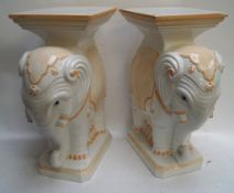 A pair of Italian china elephant form conservatory seats/plant stands