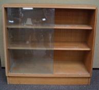 A glass sliding door oak shelved unit